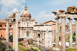 View of the Roman Forum with ruined columns of The Temple of Saturn on the right  in Rome, Italy