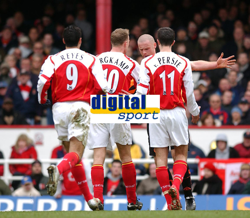 Photo. Daniel Hambury, Digitalsport<br /> Arsenal v Sheffield United. <br /> FA Cup Fifth Round.<br /> 19/2/2005.<br /> Arsenal's Dennis Bergkamp confronts Danny Cullip that led to his sending off.