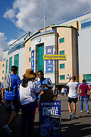 A fan buys a programme outside Stamford Bridge, home of Chelsea<br /> <br /> Photographer Craig Mercer/CameraSport<br /> <br /> Football - Barclays Premiership - Chelsea v Swansea City - Saturday 8th August 2015 - Stamford Bridge - London<br /> <br /> © CameraSport - 43 Linden Ave. Countesthorpe. Leicester. England. LE8 5PG - Tel: +44 (0) 116 277 4147 - admin@camerasport.com - www.camerasport.com