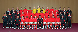 CARDIFF, WALES - Tuesday, March 22, 2011: Wales' players pose for a team group photograph at the Vale of Glamorgan Hotel...Back row L-R: media officer Karl Pedersen, Medical Officer Doctor Jon Houghton, goalkeeping coach Martyn Margetson Neal Eardley, Lewin Nyatanga, Ashley Williams, goalkeeper Lewis Price, goalkeeper Wayne Hennessey, goalkeeper Boaz Myhill, James Collins, Danny Collins, Neil Taylor, physiotherapist Andy Neaves, masseur David Rowe, fitness coach Ryland Morgans...Middle row L-R: masseur Ben Thompson, press officer Ceri Stennett, physiotherapist Michael Kuijpers, Medical Officer Doctor Mark Ridgewell, Andrew Crofts, Chris Gunter, Andy King, Steve Morison, Sam Vokes, Hal Robson-Kanu, Freddie Eastwood, Joe Allen, physiotherapist Dyfri Owen, equipment manager David Griffiths, performance analyst Esther Laugharne...Front row L-R: coach Osian Roberts, David Vaughan, Daniel Gabbidon, Gareth Bale, Aaron Ramsey, manager Gary Speed MBE, Craig Bellamy, Joe Ledley, Simon Church, Ched Evans, head of prerformance Damien Roden...(Photo by David Rawcliffe/Propaganda)