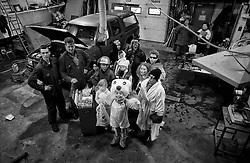 Special day when kids gets dressed in costumes and sing for candy, similar to trick or treat.  Here are the kids at workshop in the island Grimsey, north of Iceland - Börn á öskudegi í heimsókn á vélaverkstæði í Grímsey