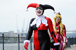 © Licensed to London News Pictures. 25/05/2018. LONDON, UK.  A cosplayer as Harley Quin attends MCM Comic Con at Excel in East London.   Thousands of fans of video games, comic books and other popular character take the opportunity to dress up as their favourite characters.  Photo credit: Stephen Chung/LNP