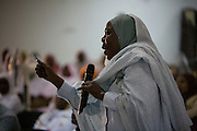 With great passion for justice, a Sudanese woman makes her point while attending the first-ever international Conference on Womens' Challenge in Darfur, gather in a compound belonging to the Govenor of Noth Darfur in Al Fasher (also spelled, Al-Fashir) where the women from remote parts of Sudan gathered to discuss peace and political issues.