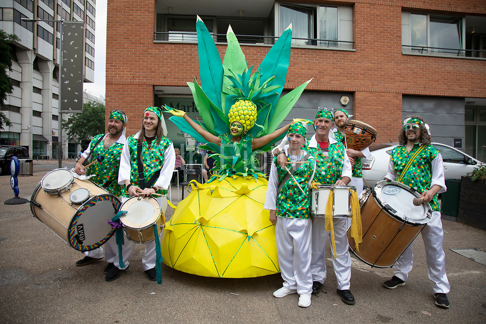 Outlandish outfits worn by some street performers from a Samba troupe in London, United Kingdom.