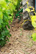 A vineyard tractor equipped with knifes to mechanically cut off remove grass and weed to minimise the need for weed killer spraying The tractor compacts the soil at the experimental vineyard of the CIVC at Plumecoq near Chouilly in the Cote des Blancs It is used for testing clones soil treatment vine treatments spraying, Champagne, Marne, Ardennes, France