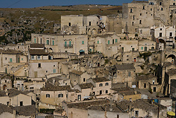 Matera, Basilicata, Italy - The Sasso Barisano, one of two ravines honeycombed with cave dwellings that make up Matera. The town in a UNESCO World Heritage Site.