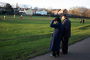 Elderly couple watch an amateur football match at Canon Hill Park on 4th January 2020 in Birmingham, United Kingdom.