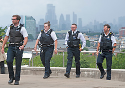 ©Licensed to London News Pictures 02/07/2020     <br /> Greenwich, UK. A large number of police arrive in the park. People out and about in Greenwich Park, Greenwich, London today as the Coronavirus lockdown is eased. The weather continues to be unsettled with heavy rain and sunshine. Photo credit: Grant Falvey/LNP