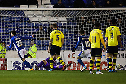 Oldham Athletic's Rhys Turner scores his sides third goal  - Photo mandatory by-line: Matt McNulty/JMP - Mobile: 07966 386802 - 24/03/2015 - SPORT - Football - Oldham - Boundary Park - Oldham Athletic v Rochdale - SkyBet League 1
