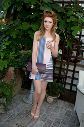 NICOLA ROBERTS attending the Warner Bros. & Esquire Summer Party held at Shoreditch House, Ebor Street, London E1 on 18th July 2013.