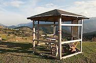 Shelter with picnic table at Pepaj, Peaks of the Balkans trail Kosovo © Rudolf Abraham