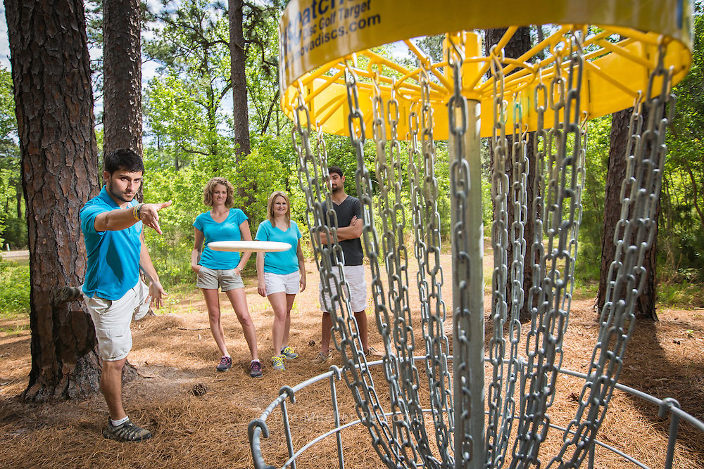 Jordan Sellers throws a disc during a disc golf game at the new Bob Rodgers Memorial Disc Golf Course at Sam Houston Jones State Park near Lake Charles, La. Disc golf players, from background left, Cherie Knox, Kaylen Fletcher and Joseph Peters watch as Sellers makes his throw.