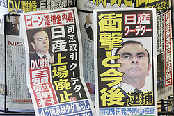 November 20, 2018 - Tokyo, Japan - Japanese newspapers report on its front pages that Nissan CEO Carlos Ghosn had been arrested on suspicion of financial misconduct, in Tokyo. Nissan said on Monday that Carlos Ghosn, who also heads an alliance of the Renault-Nissan-Mitsubishi, has been arrested (and will be dismissed) for suspicion of under-reporting his corporate salary and using company assets for his personal benefit. (Credit Image: © Rodrigo Reyes Marin/ZUMA Wire)