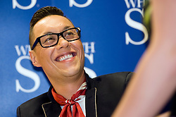 "Gok Wan Signs Copies of his autobiography ""Through Thick and Thin"" and poses for photos with fans at WH Smiths Meadowhall Sheffield  20th October 2010 <br /> Images © Paul David Drabble"
