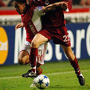 NLD/Amsterdam/20051122 - Voetbal, Champions League, Ajax - Sparta Praag, Steven Pienaar (10) in duel met Michal Kadlec (23)