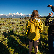 A Teton Teton Science Schools wildlife tour stops to explore the balsamroot flowers along the Antelope Flats Road in Grand Teton National Park, Wyoming.(Tracy Logan and Dawson)