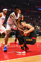 January 28, 2019 - Los Angeles, CA, U.S. - LOS ANGELES, CA - JANUARY 28: Atlanta Hawks Guard Jeremy Lin (7) falls down being defended by Los Angeles Clippers Guard Shai Gilgeous-Alexander (2) during a NBA game between the Atlanta Hawks and the Los Angeles Clippers on January 28, 2019 at STAPLES Center in Los Angeles, CA. (Photo by Brian Rothmuller/Icon Sportswire) (Credit Image: © Brian Rothmuller/Icon SMI via ZUMA Press)