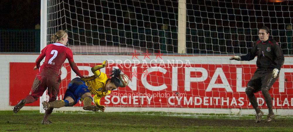 BROUGHTON, ENGLAND - Wednesday, March 31, 2010: Wales' goalkeeper Rhian Nokes is beaten by Sweden's Jessica Landstrom for the fourth goal during the FIFA Women's World Cup 2011 Qualifying Group 8 match at the Airfeld. (Pic by David Rawcliffe/Propaganda)