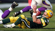 Green Bay Packers' Brett Favre is knocked in the head by Minnesota Vikings' Kenechi Udeze in the 3rd quarter. Kenechi Udeze was called for a personal foul on the play.. The Green Bay Packers hosted the Minnesota VIkings at Lambeau Field Sunday November 11, 2007. Steve Apps-State Journal.