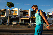 A man in a face mask walks past empty and shuttered bars and restaurants in Puerto Del Carmen, Lanzarote, Spain on 21st November 2020. Beaches and resorts across the island are nearly deserted since tourism plummeted due to Covid restrictions elsewhere in Europe. Although the Canary Islands have been relatively unscathed by the virus, with 155 lives lost from 2.1 million residents, the region is heavily dependent on tourism and locals are hoping that numbers recover as lockdown measures ease and vaccines potentially reduce the numbers of infections.
