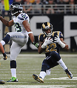 Football - NFL- Seattle Seahawks at St. Louis Rams.St. Louis Rams cornerback Trumaine Johnson (22) falls to the turf after making an interception catch in the second quarter on a Seahawks pass that was intended for Seattle Seahawks wide receiver Doug Baldwin (89)