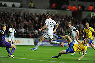 Swansea city's Ben Davies © scores his goal to make it 1-2. Barclays Premier league, Swansea city v Arsenal at the Liberty Stadium in Swansea on Saturday 28th Sept 2013.  pic by Andrew Orchard, Andrew Orchard sports photography.