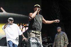 © Licensed to London News Pictures. 26/08/2012.  London, UK.  Chuck D (middle), Flavour Flav (left) and Professor Griff (right) of Public Enemy live at South West Four/SW4 on Clapham Common during the August Bank Holiday Weekend.  Photo credit : Richard Isaac/LNP