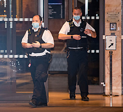 © Licensed to London News Pictures. 26/02/2021. London, UK. Police officers attend as the first travellers leave the Radisson hotel near Heathrow Airport after their quarantine period ended. New quarantine measures were introduced for travellers form red list countries, who are required to isolate for ten days in a hotel at a cost of £1,750 per person. Photo credit: Ben Cawthra/LNP
