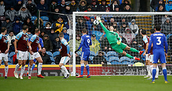 Leicester City's James Maddison (not in picture) scores his side's first goal of the game past Burnley goalkeeper Thomas Heaton (centre) during the Premier League match at Turf Moor, Burnley.