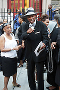 July 24, 2012-New York, NY:  New York State Senator Bill Perkins attends the official Slyvia Woods Harlem Community memorial and send off through the streets of Harlem. Sylvia Woods was an American restaurateur who co-founded the landmark restaurant Sylvia's in Harlem on Lenox Avenue, New York City with her husband, Herbert Woods, in 1962. (Photo by Terrence Jennings)