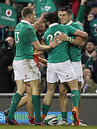 Tiernan O'Halloran celebrates after scoring a try for Ireland with Garry Ringrose and Joe Carbery during the 2016 Guinness Series  autumn international rugby match, Ireland v Canada at the Aviva Stadium in Dublin, Ireland on Saturday 12th November 2016.<br /> pic by  John Halas, Andrew Orchard sports photography.