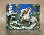 Enamelled terracotta relief panel of Saint George sleighing the Dragon. Made in Florence around 1520. Inv RF 3096, The Louvre Museum, Paris. .<br /> <br /> If you prefer you can also buy from our ALAMY PHOTO LIBRARY  Collection visit : https://www.alamy.com/portfolio/paul-williams-funkystock/florentine-enamel-antiquities.html <br /> <br /> Visit our MEDIEVAL ART PHOTO COLLECTIONS for more   photos  to download or buy as prints https://funkystock.photoshelter.com/gallery-collection/Medieval-Gothic-Art-Antiquities-Historic-Sites-Pictures-Images-of/C0000gZ8POl_DCqE