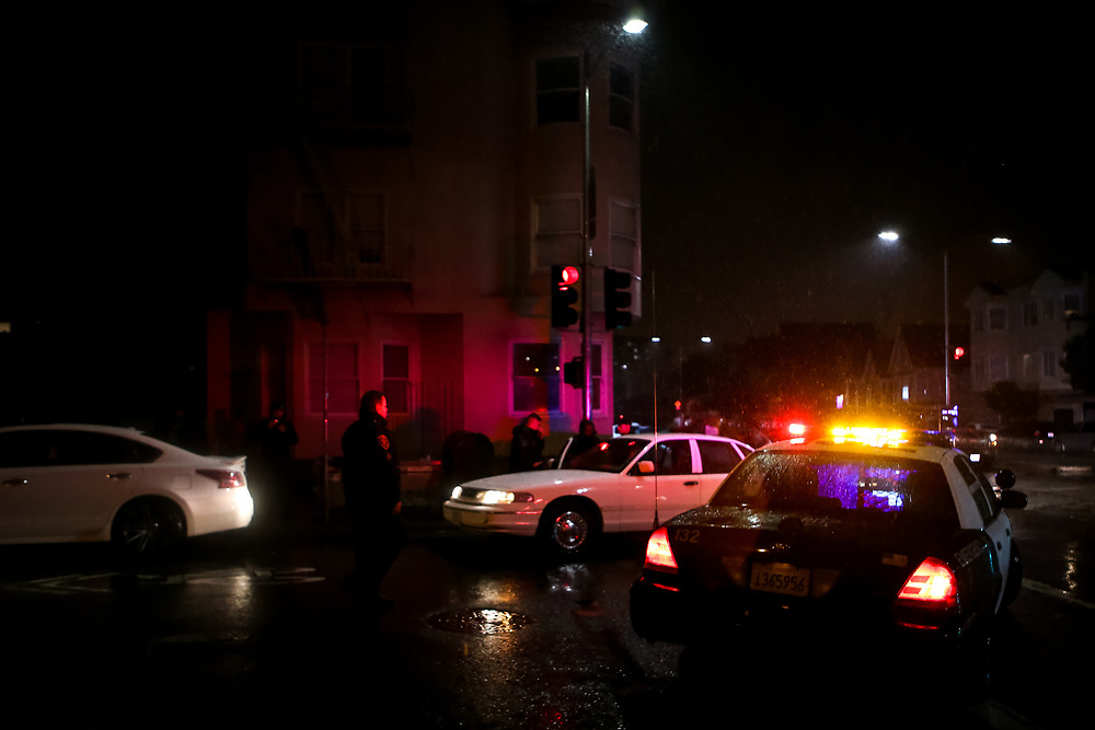 An SFPD police officer stands guard after an operation on 29th Street near San Jose Avenue in San Francisco, Calif., Thursday, October 27, 2016.