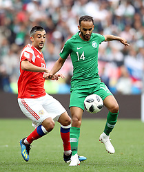 Russia's Aleksandr Samedov (left) and Saudi Arabia's Abdullah Otayf battle for the ball during the FIFA World Cup 2018, Group A match at the Luzhniki Stadium, Moscow.