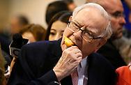 Berkshire Hathaway CEO Warren Buffett enjoys an ice cream treat from Dairy Queen before the Berkshire Hathaway annual meeting in Omaha, Nebraska May 6, 2017. REUTERS/Rick Wilking