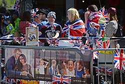Royal fans wait to watch members of the armed forces in a parade rehearsal in Windsor, Berkshire ahead of the wedding of Prince Harry and Meghan Markle this weekend.