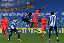 Steve Mounie of Huddersfield Town and Moses Odubajo of Sheffield Wednesday - Mandatory by-line: Daniel Chesterton/JMP - 24/06/2020 - FOOTBALL - Hillsborough - Sheffield, England - Sheffield Wednesday v Huddersfield Town - Sky Bet Championship