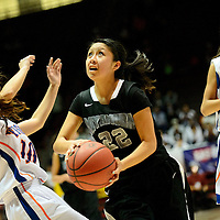 031114  Adron Gardner/Independent<br /> <br /> Miyamura Patriot Raquel Spencer (22) drives into the lane  during the state high school basketball tournament at The Pit in AlbuquerqueTuesday.