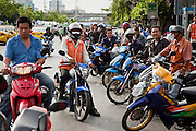 May 19 - BANGKOK, THAILAND: Thais gather on Rama IV Road to watch the Thai Army attack anti government positions in Lumpini Park Wednesday. The Royal Thai Army attacked anti-government protesters May 19 with troops and armored personnel carriers. Photo by Jack Kurtz