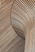 Cedar wood strips clad the wind cowl above the debating chamber in the National Assembly for Wales Senedd (Senate) Building. Architect: Richard Rogers Partnership, 2006. Cardiff Bay, Wales.