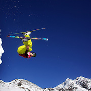 Snowboarder Sam Massey, 18, from Queenstown, New Zealand, takes to the air at The Remarkables Ski Fields, Queenstown, New Zealand during a session with 'The Air Bag'  a large inflatable airbag which breaks the fall of the participant on landing and allows valuable experience and a training aid for Aerial skiers and snowboarders. Queenstown, South Island, New Zealand, 18th July 2011