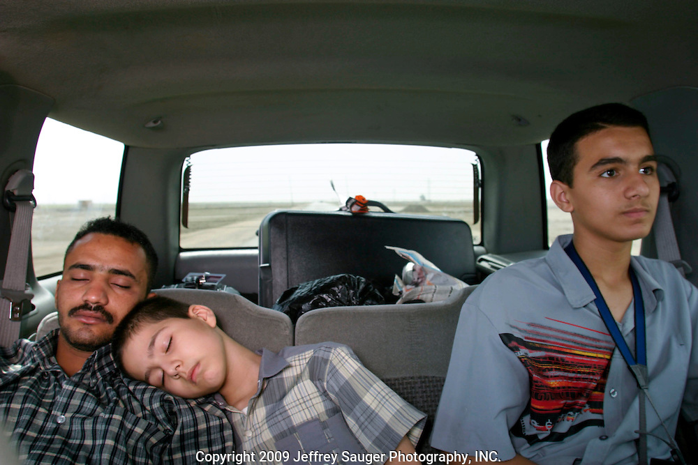 On the road to Nasiriyah from Karbala, Iraq. Hussein Al-Kasid, 15, right, and Aladdin Al-Kasid, 8, center, with a family friend.