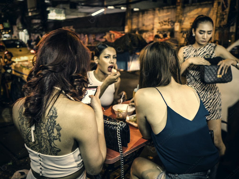 A group of ladyboys at Sukhumvit Soi 4 where Nana Plaza red light district is located. This street and Nana Square a complex with many gogo bars open everyday catering for foreign customers. Ladyboys or Kathoey usually refer to transgender women in Thailand.