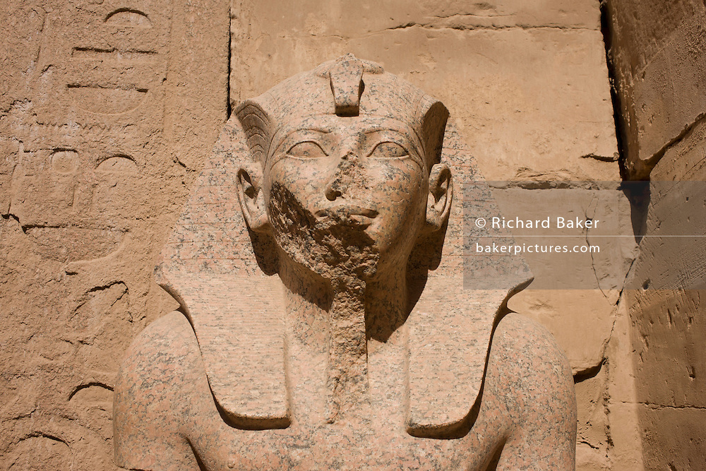 A detail of the seated statue of Pharaoh Thutmose III at the Temple of Karnak, Luxor, Nile Valley, Egypt. Thutmose III was the sixth Pharaoh of the Eighteenth Dynasty. During the first twenty-two years of Thutmose's reign he was co-regent with his stepmother and aunt, Hatshepsut, who was named the pharaoh.