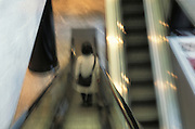 Person ascending an escalator