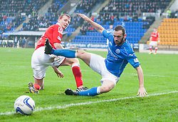 Ross County's Scott Boyd and St Johnstone's James McFadden. <br /> St Johnstone 2 v 1 Ross County, Scottish Premiership 22/11/2014 at St Johnstone's home ground, McDiarmid Park.