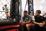 Wrestling coach Izzy Martinez and UFC flyweight Sergio Pettis look on as UFC bantamweight Holly Holm spars at Jackson Wink MMA in Albuquerque, New Mexico on June 9, 2016.