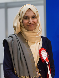 © Licensed to London News Pictures. 12/06/2015. London, UK. Independent candidate, RABINA KHAN listens to JOHN BIGGS winning speech. Lutfur Rahman was removed from office for fraud and corrupt practices by an election court earlier this year and the 2014 election was rerun as a result. Photo credit : Vickie Flores/LNP