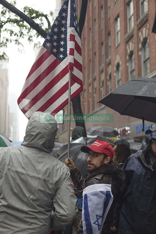 June 5, 2017 - New York, United States - People protest at against CUNY's commencement speaker pick, Muslim Linda Sarsour in New York, US, on 5 June 2017.After months of campaigning to disinvite civil rights activist and co-organizer of the Women's March, Linda Sarsour, from giving a graduation speech at the City University of New York (CUNY), Sarsour's keynote went last 1st June. (Credit Image: © Shay Horse/NurPhoto via ZUMA Press)