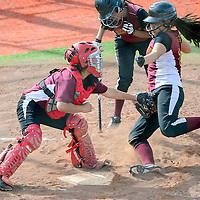 050614       Adron Gardner<br /> <br /> Tohatchi Cougar Shawnray Plummer (1), left, tags out a sliding Rehoboth Lynx Delicia Begay (10) at Ford Canyon Park in Gallup Tuesday.